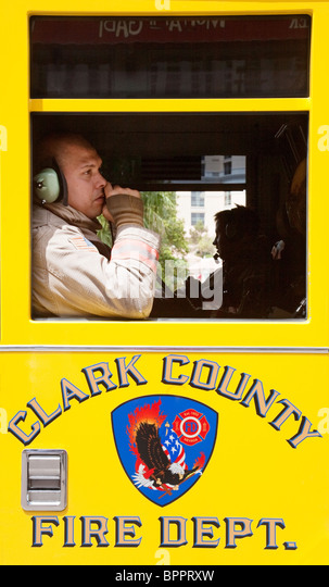 A Clark County fireman in his firetruck, Las Vegas Nevada USA - Stock Image