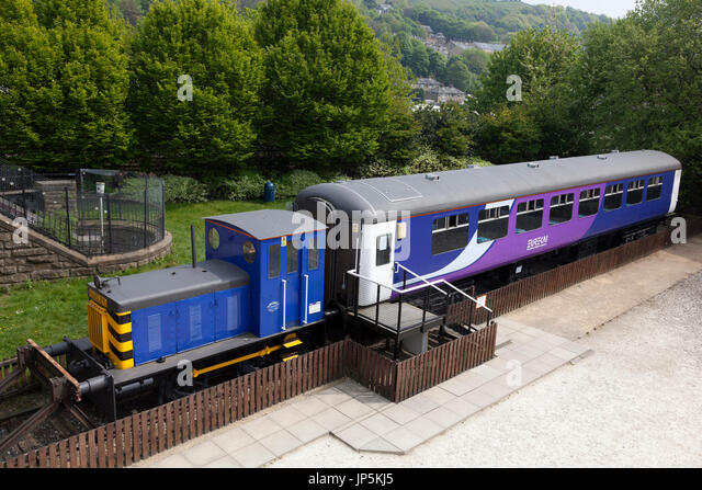 Railway carriage and engine at the Eureka Childrens Museum,  Halifax, West Yorkshire - Stock Image
