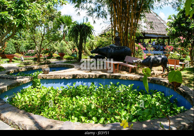 Beautiful gardens at an outdoor restaurant in the Mekong Delta. Vietnam - Stock Image