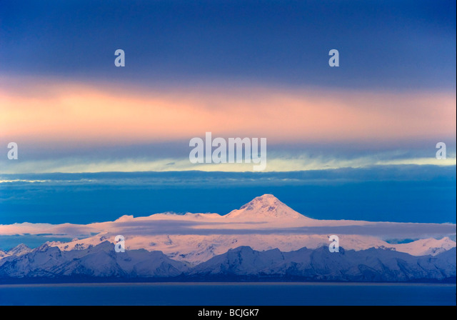 Iliamna Volcano seen across Cook Inlet from the Kenai Peninsula in Southcentral Alaska during Winter - Stock Image