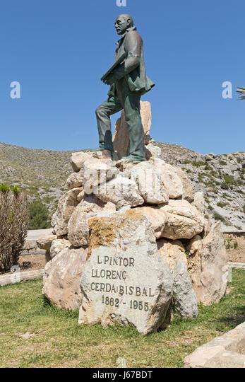 statue of the painter Llorenc Cerda-Bisbal in Cala de Sant Vicenc, Majorca, Spain - Stock Image