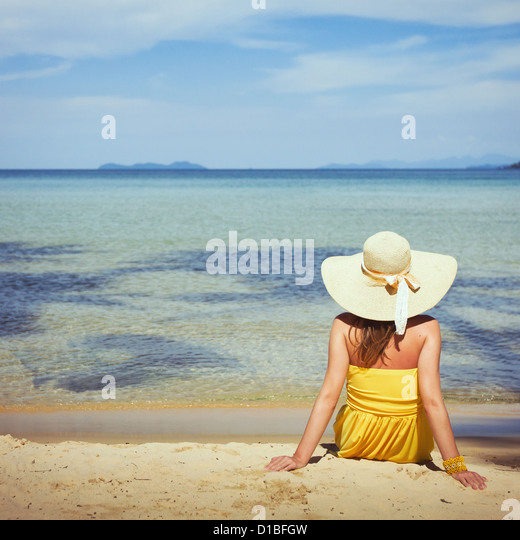 travel, woman on the beach in tropics - Stock Image