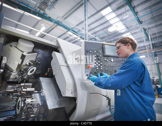 Female engineer with machinery - Stock Image