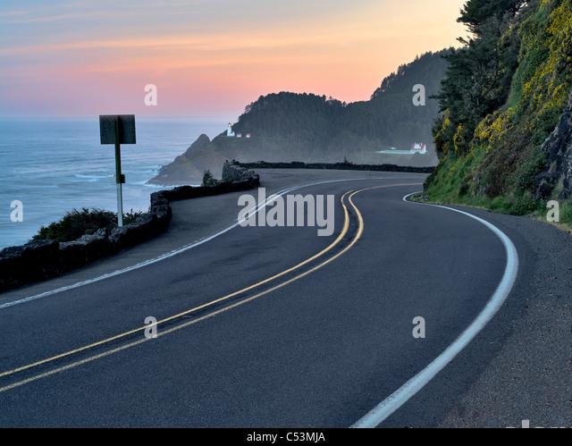 Road leading to Heceta Lighthouse at sunrise. Oregon - Stock Image