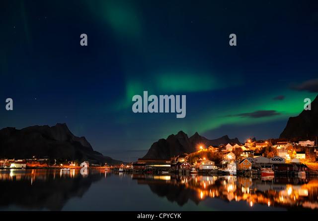 Norway, Nordland County, Lofoten Islands, Moskenes Island, aurora borealis over Reine fishermen village - Stock Image