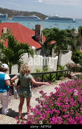 St. Thomas USVI Charlotte Amalie Blackbeard's Hill 99 Steps cruise ships Bougainvillea flowers - Stock Image