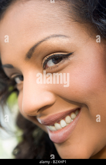 Head shot of woman smiling - Stock Image