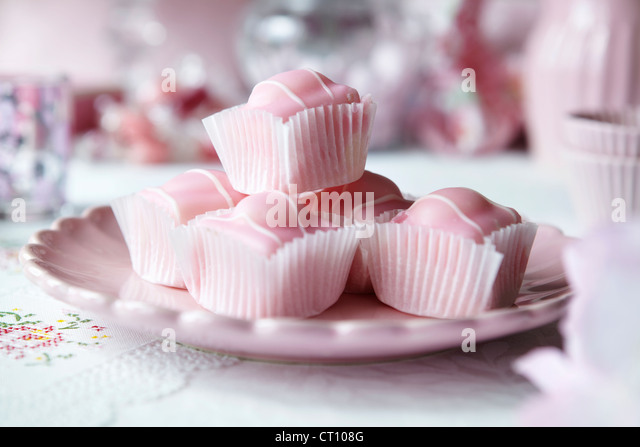Close up of plate of candies - Stock Image