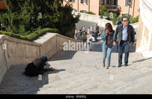 Beggar on the Spanish Steps Rome - Stock Image