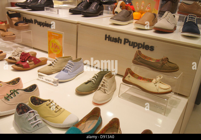 Singapore City Square Mall shopping for sale retail display fashion front entrance shoes Hush Puppies - Stock Image