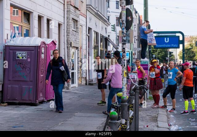 Berlin, Germany, 25th September, 2016. Athelete queue at toilet during Berlin Marathon at the 10 Kilometer mark - Stock Image
