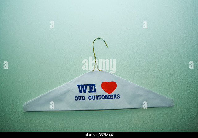 Close-up of text We Love Our Customer painted on a cloth on a hanger, New York City, New York State, USA - Stock-Bilder