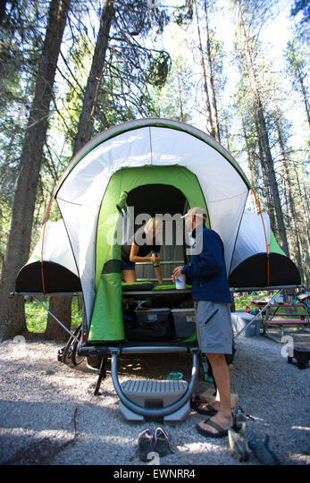 Family camping in new, lightweight travel trailer - Stock Image