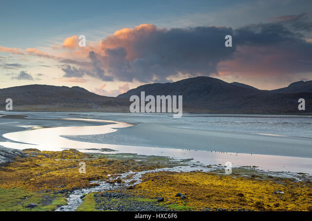 Clouds over tranquil mountains and ocean, Luskentyre Beach, Harris, Outer Hebrides - Stock Image