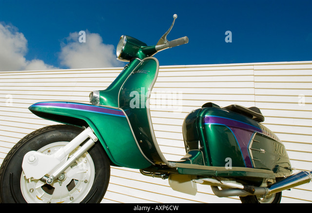 1960s retro vintage mod Lambretta Vespa motorbike motor scooter rockers RAC chrome under blue sky green turquoise - Stock Image