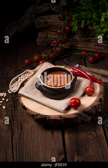 beans with piquant Tomato sauce - Stock Image