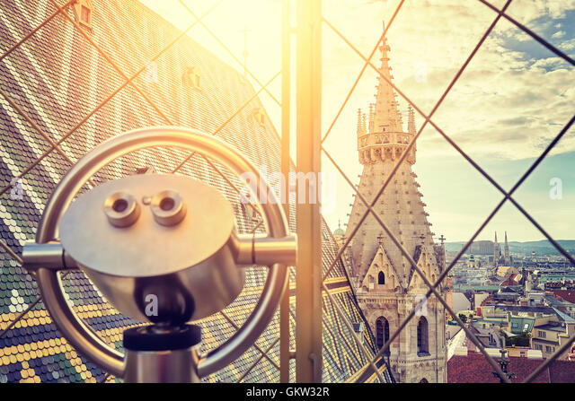 Vintage toned tourist binoculars over Vienna at sunset, view from the north tower of St. Stephen's Cathedral. - Stock Image