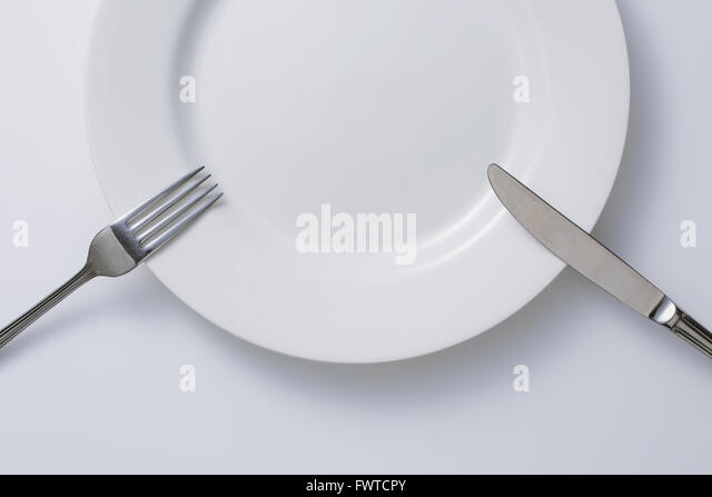 Empty plate and cutlery - Stock Image