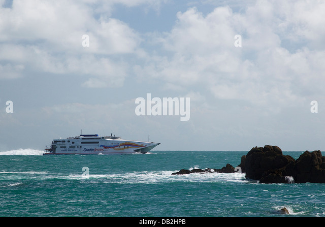 Condor ferry passing Corbiere Point Jersey Channel Islands, UK LA005978 - Stock-Bilder