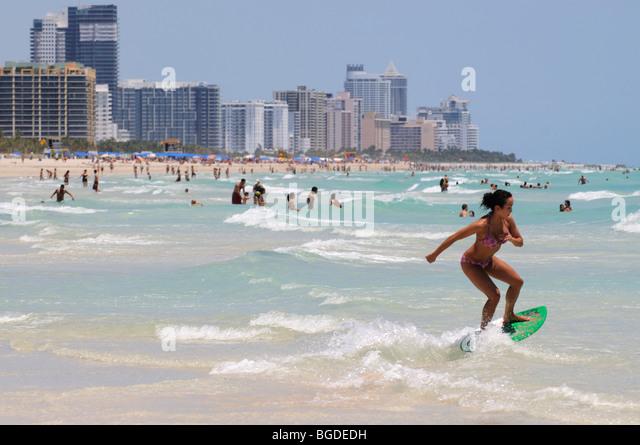 Surfer, skimboarder, Miami South Beach, Art Deco district, Florida, USA - Stock Image