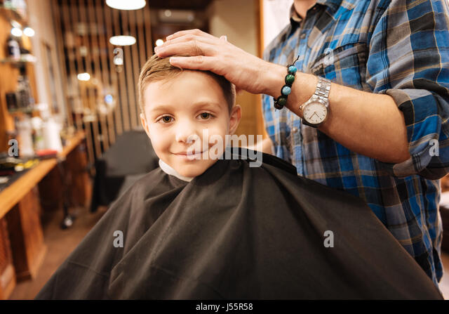 barber haircut child stock photos barber haircut child stock images alamy. Black Bedroom Furniture Sets. Home Design Ideas