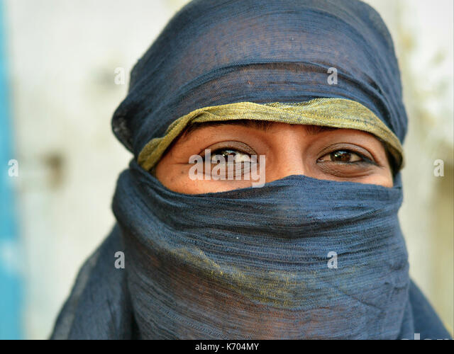 Mature Indian Muslimah with smiling eyes and black niqab; Ahmedabad, Gujarat, Western India - Stock Image