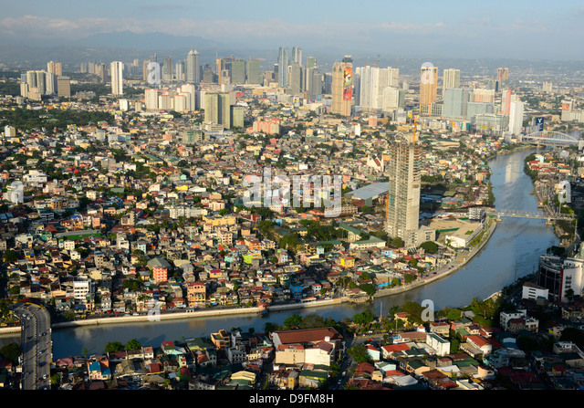 Tall buildings on Ortiga Avenue, Pasig River and Mandaluyong beyond, Metromanila, Philippines, Southeast Asia - Stock Image