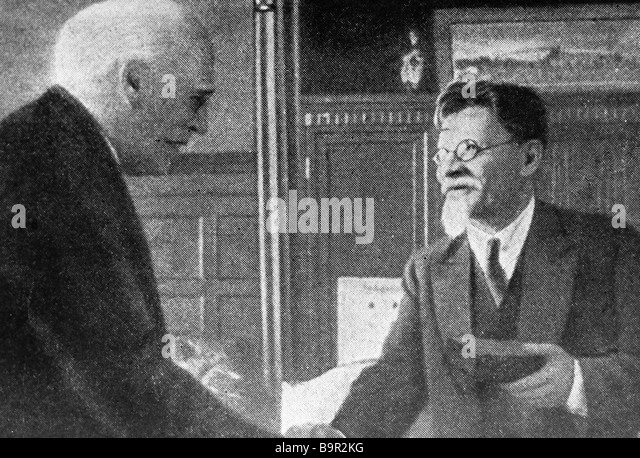 Mikhail Kalinin right presents the Order of the Red Banner to Konstantin Stanislavsky left - Stock Image