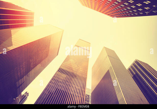 Vintage stylized photo of skyscrapers in Manhattan at sunset, New York City, USA. - Stock Image