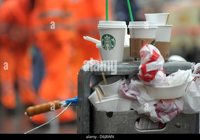 A trash can overflows during a rally on occasion of the strike in the public service sector in Nuremberg,Germany, - Stock Image