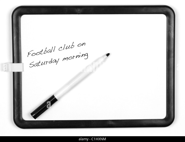 White message board and black marker pen with the message 'Football club on Saturday morning' - white background. - Stock-Bilder