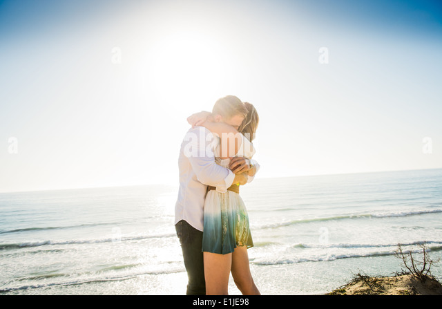 Romantic young couple hugging each other at coast - Stock-Bilder