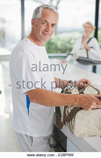 Man tennis racquet in gym bag - Stock Image