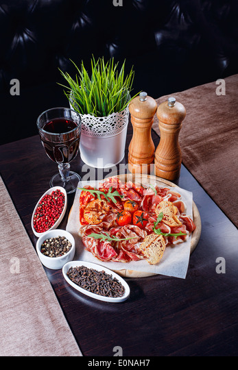 Bacon and sun-dried tomatoes shot closeup, restaurant food - Stock Image