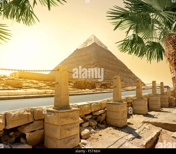 Pyramid of Khafre and asphalted road with columns - Stock Image