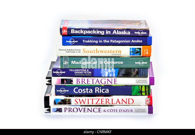 Collection showing assortment of travel guides and guidebooks about worldwide holiday destinations - Stock-Bilder