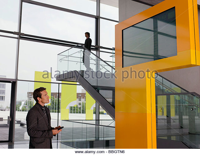 Businessman looking at information monitor - Stock Image