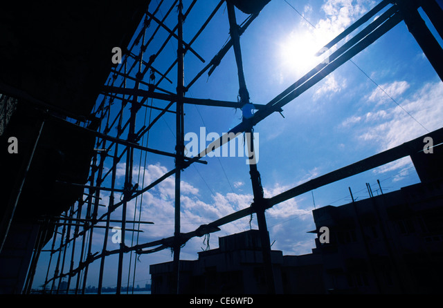 STP 86018 : bamboo scaffolding structure sun white clouds blue sky india - Stock Image