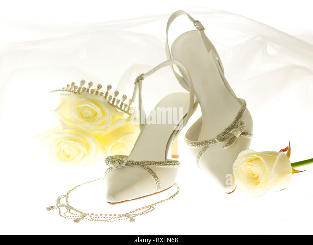womens white wedding shoes with tiara and necklace - Stock Image