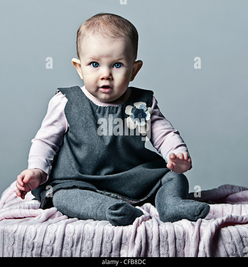 Beauty Baby girl in Grey Dress - Stock Image