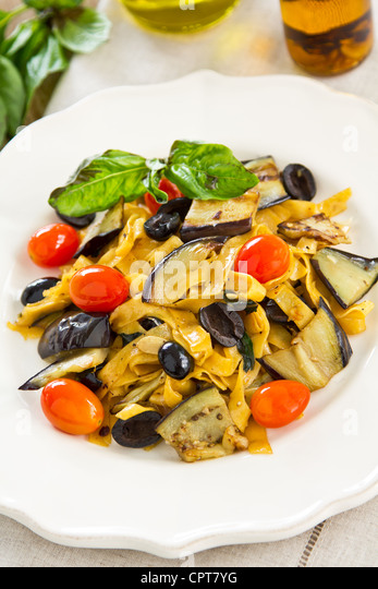 Carrot Fettuccine with aubergine and olive - Stock Image