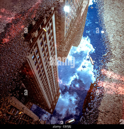 USA, new York State, New York City, Skyscraper reflecting in puddle - Stock-Bilder
