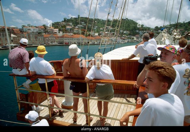 Grenada St. George's Carenage Harbor Barefoot Windjammer SV Fantome schooner cruise ship passengers arriving - Stock Image