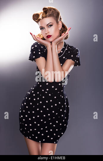 Styled Young Female in Blue Polka Dot Dress - Vintage fashion Style - Stock Image