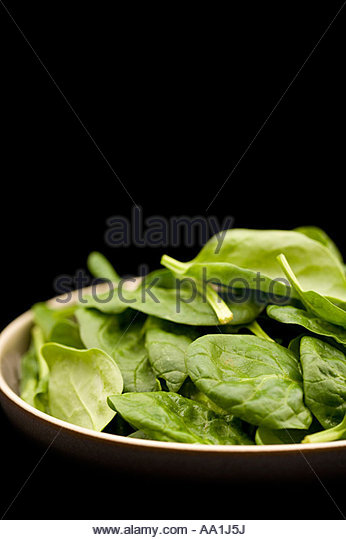 Bowl of spinach leaves - Stock Image