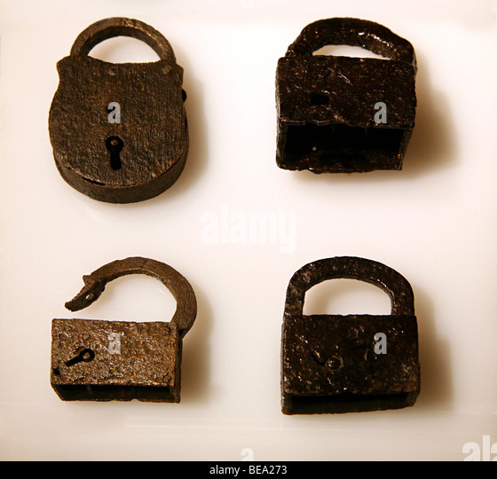 Close up detail of old-fashioned metal padlocks - Stock Image