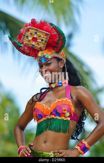 Woman dancer in traditional dress during a show at Punta Cana, Dominican Republic, Caribbean - Stock Image