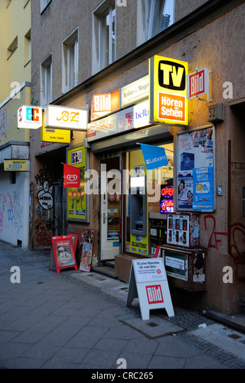 Advertising and billboards on a kiosk in Kreuzberg Schlesisches Tor, Berlin, Germany, Europe - Stock Image