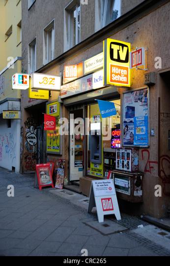 Advertising and billboards on a kiosk in Kreuzberg Schlesisches Tor, Berlin, Germany, Europe - Stock Image