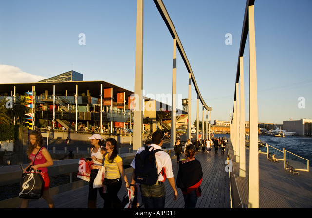 Barcelona Port Vell Rambla de Mar walkway crowds at sunset - Stock Image